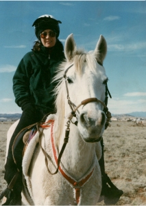 Riding my mare Opal one blustery day when she had a lot of energy. She was retired early because of melanomas. Photo taken Winter, 1998.