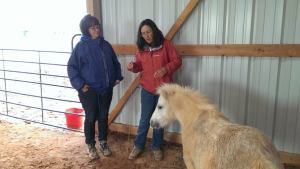Elijah helps teach Beth all about horses